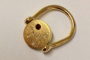 Bespoke garnet and diamond greek spin ring handmade in 18ct yellow gold by charmian beaton design