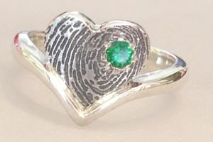Emerald finger print ring handmade at charmian beaton design