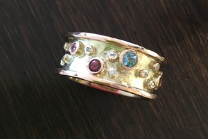 handmade 9ct gold ring remodel set with scattered diamonds and aqua, garnet and pink sapphire by charmian beaton design