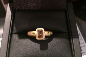 Handmade engagement ring set with rough, uncut chocolate diamonod, green tourmaline and diamonds set in 18ct yellow gold by charmian beaton design