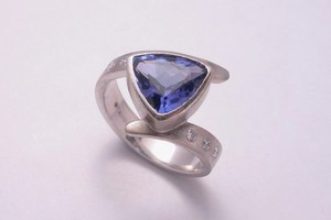 Trillion cut tanzanite and diamond dress ring hand made in 18ct white gold by charmian beaton design