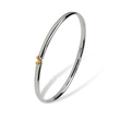 Gold heart bangle by Linda Macdonald